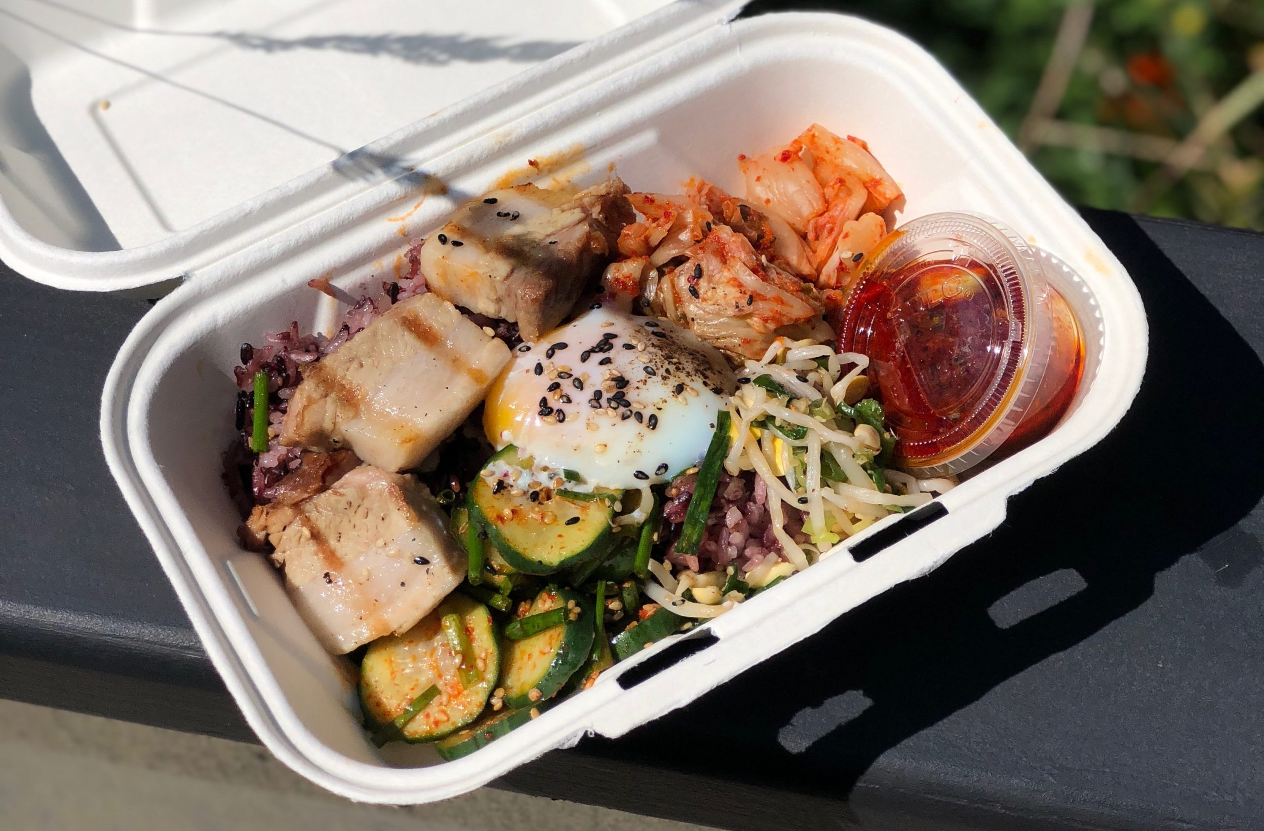 Bibimbop in a compostable to-go container