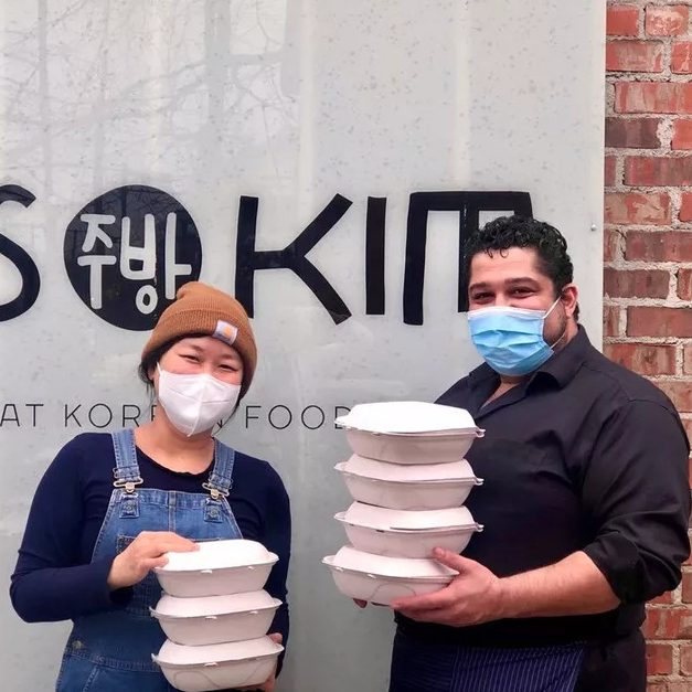 Ji Hye Kim with Omar Anani with takeout containers